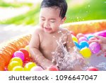 asian baby play a water and... | Shutterstock . vector #1096647047