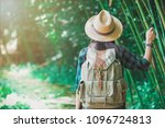 a woman with a backpack and a... | Shutterstock . vector #1096724813