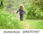 childhood. child run on path in ... | Shutterstock . vector #1096747457