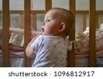 the baby is standing in a room... | Shutterstock . vector #1096812917