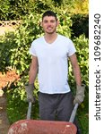 Man holding garden tools/Man working in Garden/Man working in his garden during the early morning - stock photo