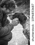Small photo of man's affection for his english setter dog in black and white