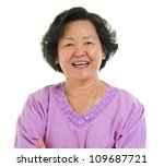 60s cheerful Asian senior woman smiling over white background - stock photo