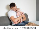 dad and baby sitting on the... | Shutterstock . vector #1096905533