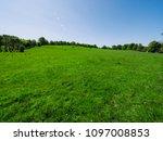 sunny spring countryside... | Shutterstock . vector #1097008853