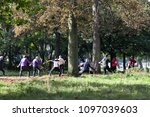 Small photo of Paris, France - September 23, 2017: Middle-aged and elderly people are engaged in physical exercises in Park to maintain tone in open air. Healthy lifestyle. Rapid aging of Europe's population