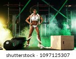 young woman in the gym with a... | Shutterstock . vector #1097125307