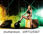 young woman in the gym with a... | Shutterstock . vector #1097125367