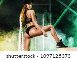 young woman in the gym with a... | Shutterstock . vector #1097125373