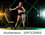 young woman in the gym with a... | Shutterstock . vector #1097125403