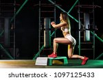 young woman in the gym with a... | Shutterstock . vector #1097125433