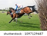 Small photo of Shady Glen (IRE) ridden by Kielan Woods jumps the last fence and wins the 3m Handicap Chase at Market Rasen Races : Market Rasen Racecourse, Lincs, UK : 11 May 2018 : Pic Mick Atkins
