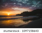 warm sunset over the pacific... | Shutterstock . vector #1097158643