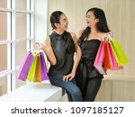 two happy asain woman holding... | Shutterstock . vector #1097185127