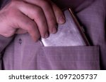 Small photo of addict hides a cigarette box in his pocket, toning