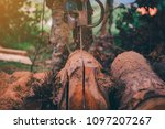 chainsaw in action cutting wood.... | Shutterstock . vector #1097207267