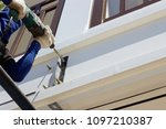the technician is using a drill ... | Shutterstock . vector #1097210387