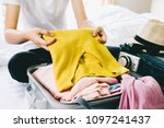 woman packing travel bag for... | Shutterstock . vector #1097241437