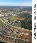 Small photo of An aerial view of a new suburban subdivision development, being built on former farm land