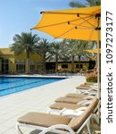 the sun loungers by the pool . ... | Shutterstock . vector #1097273177