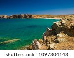 rocky coast. beach in greece.... | Shutterstock . vector #1097304143