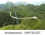 Surved suspension bridge for pedestrian on Cincang mountain Langkawi - stock photo