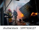 firefighters on fire. fireman... | Shutterstock . vector #1097326127