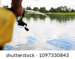a man with a fishing rod on the ... | Shutterstock . vector #1097330843