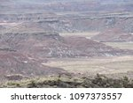 Small photo of Painted desert hills with a bit of leftover snow