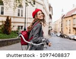 laughing curly dark haired girl ... | Shutterstock . vector #1097408837