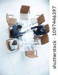 handshake across the table.... | Shutterstock . vector #1097446397
