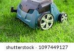 scarifier on green grass. work... | Shutterstock . vector #1097449127
