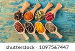 various spices in wooden spoons ... | Shutterstock . vector #1097567447