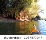 bow of yellow kayak. kayaking... | Shutterstock . vector #1097577047