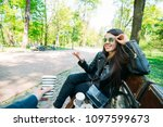 couple sitting on bench...   Shutterstock . vector #1097599673