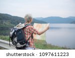 young man traveler with map...   Shutterstock . vector #1097611223