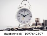 clock and rows of coins for...   Shutterstock . vector #1097642507