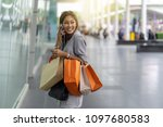asian woman using the smart... | Shutterstock . vector #1097680583