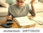 woman doing her home finances   Shutterstock . vector #1097720153
