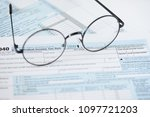 us tax form and glasses....   Shutterstock . vector #1097721203