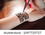 artist applying henna tattoo on ... | Shutterstock . vector #1097725727