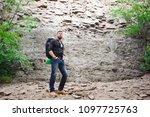 man traveler with backpack...   Shutterstock . vector #1097725763