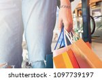close up hand holding shopping...   Shutterstock . vector #1097739197