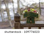 Bird House On Railing With...