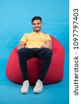 young smiley man sitting on a... | Shutterstock . vector #1097797403