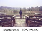man on mountains lake | Shutterstock . vector #1097798627