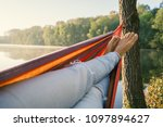 young woman by the lake hanging ... | Shutterstock . vector #1097894627