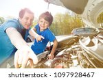 happy father and son working on ... | Shutterstock . vector #1097928467