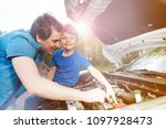 young father teaching his... | Shutterstock . vector #1097928473