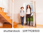 brother and sister arriving... | Shutterstock . vector #1097928503